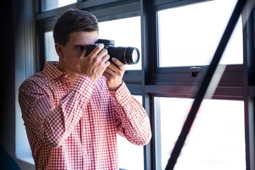 Man clicking photo from camera