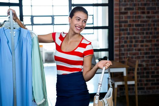 Woman selecting an apparel while shopping for clothes