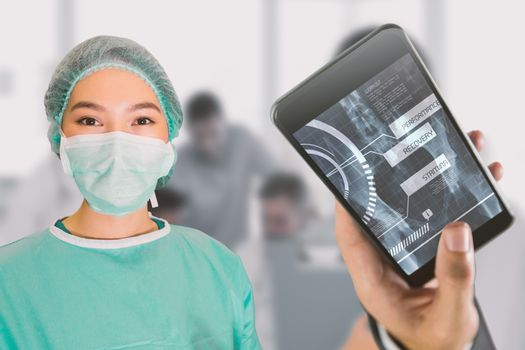 Portrait of surgeon woman against cheerful young surgeon posing with colleagues in background