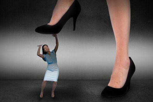 Composite image of businesswoman stepping