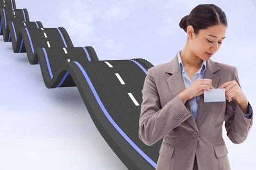 Composite image of portrait of a businesswoman clipping her badge