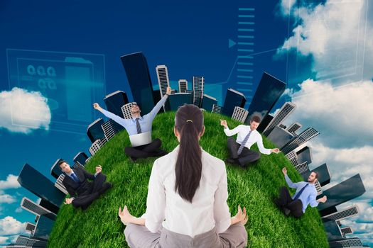 Businesswoman sitting in lotus pose against scenic view of blue sky