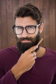 Hipster man doing his beard