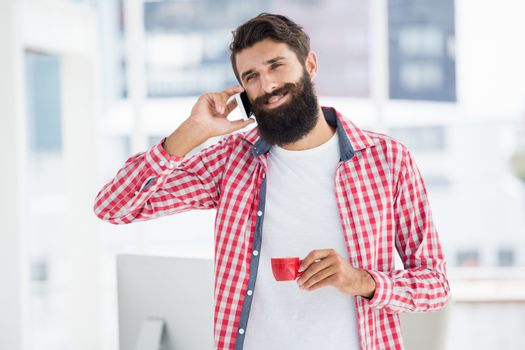 Hipster calling someone