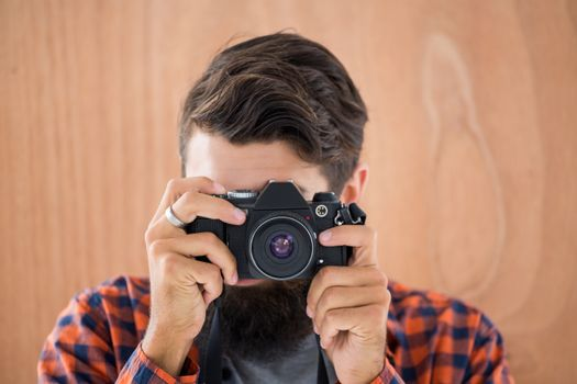 Hipster taking pictures