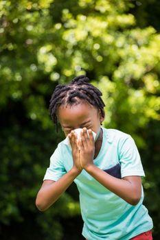 Boy sneezing his nose
