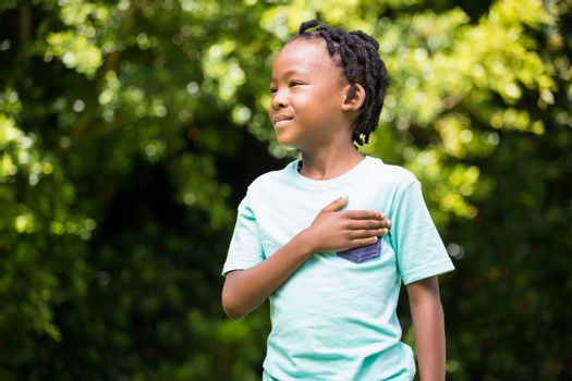 Boy with his hand on chest