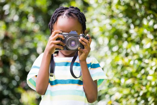 A child is taking pictures
