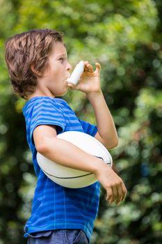 A little boy is breathing an asthma medication