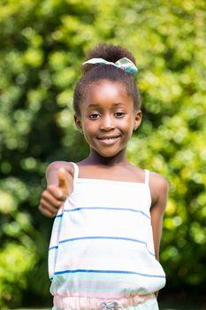 Mixed-race girl throwing up thumb