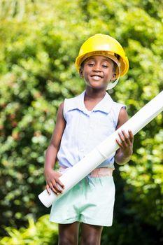 Cute mixed-race girl wearing handyman clothes