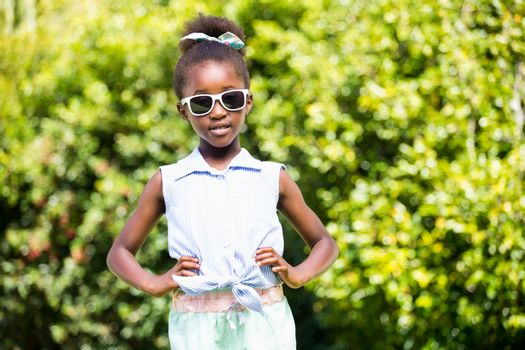 Cute mixed-race girl posing with sunglasses