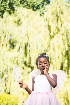 Cute mixed-race girl wearing a fairy dress