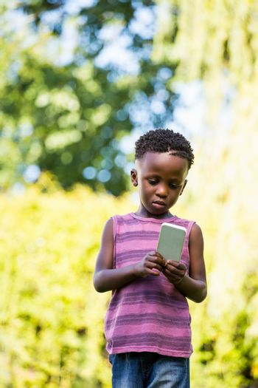 Cute mixed-race boy using a smartphone
