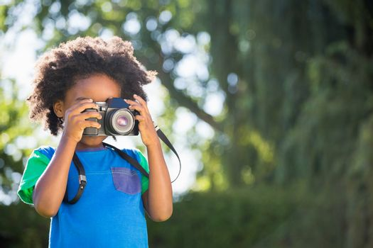 Boy is taking pictures