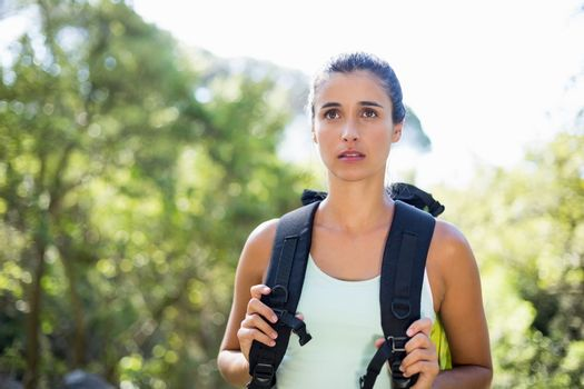 Woman unsmiling posing with her backpack