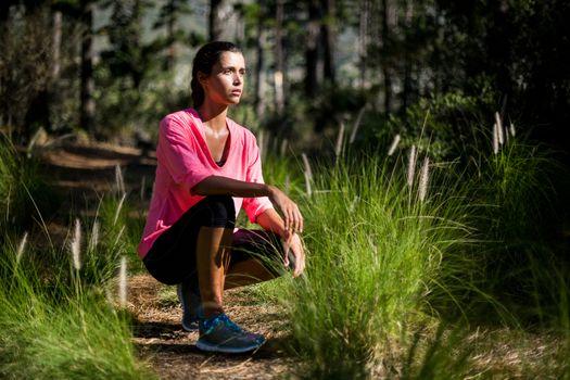 Woman unsmiling posing squat