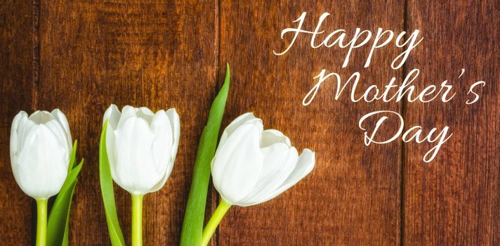 Happy mothers day against tulip flowers