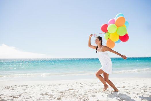 Beautiful woman holding balloon