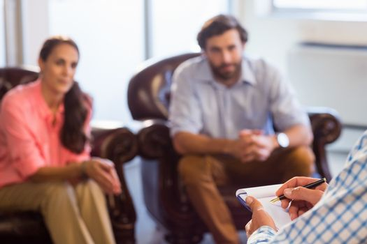 Psychologist helping a couple with relationship difficulties