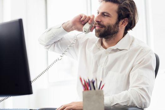 Businessman passing a call