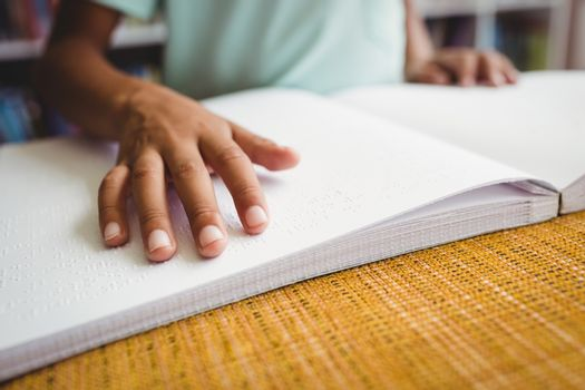 Boy using braille to read