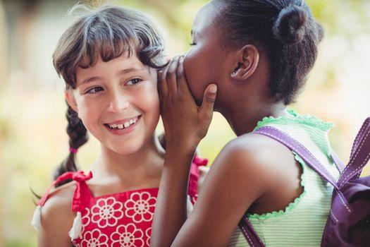 Girl telling a secret