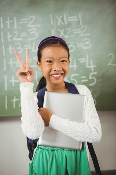 Schoolgirl doing the peace sign