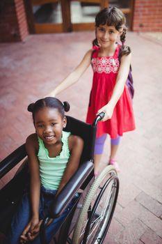 Girl pushing a friend