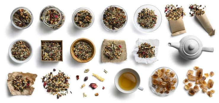 Herbal tea and accessories top view on white background.