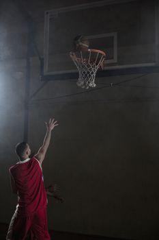 Portrait of basketball player scoring a goal