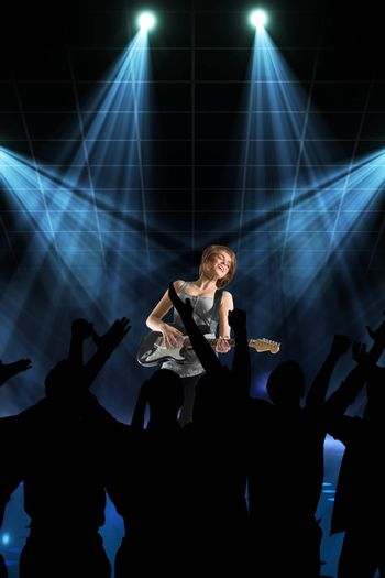 Composite image of people enjoying a concert in a black background