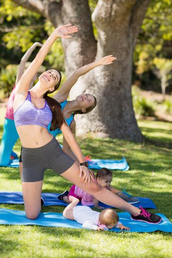 Women exercising with their babies
