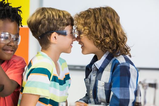 Kids rubbing their nose in classroom