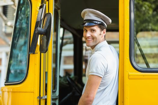 Portrait of bus driver smiling while entering in bus