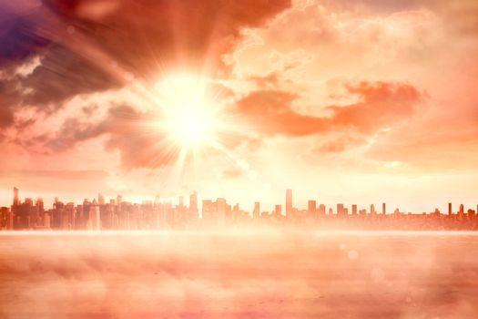 Sun shining over city