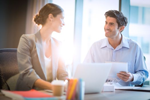 Businesswoman having a discussion with coworker