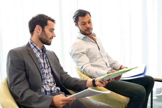 Businessman interacting with coworker