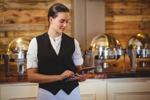 Waitress using a tablet