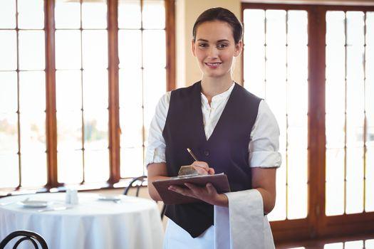 Waitress holding a clipboard
