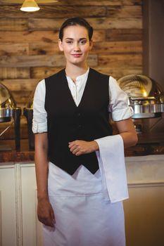 Smiling waitress standing