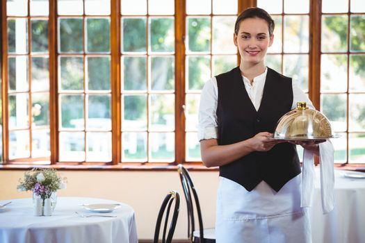 Waitress holding a dish