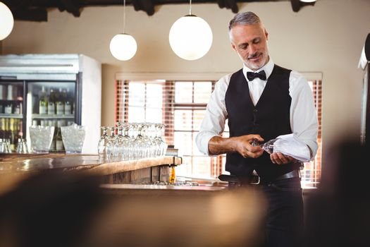 Bartender cleaning wineglass