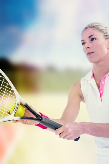 Concentrated athlete playing tennis