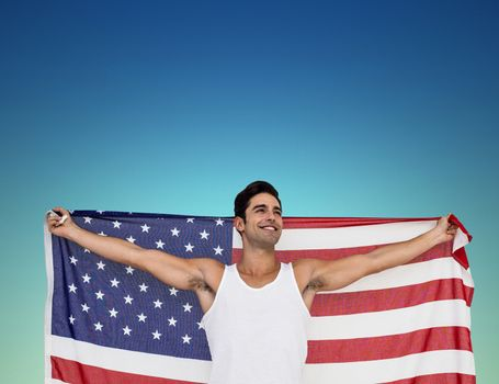 Athlete posing with american flag after victory against dark blue green background