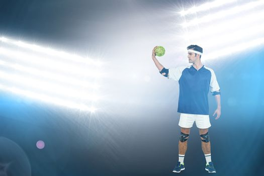 Sportsman posing with ball