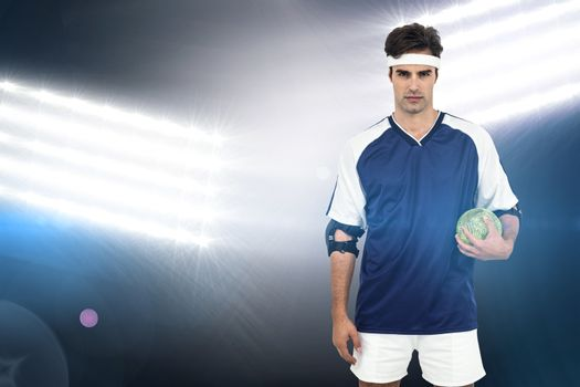 Sportsman standing with ball