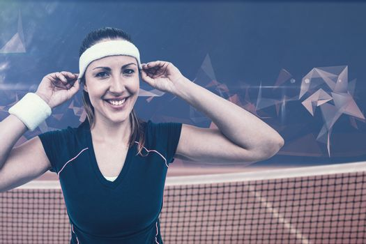 Composite image of female athlete wearing headband and wristband