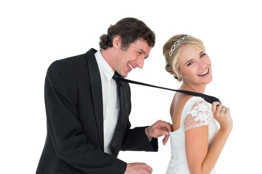 Playful newlywed couple