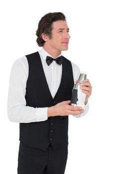 Thoughtful bartender holding cocktail shaker